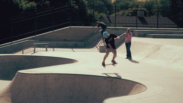Shot of skater doing a few tricks at a skatepark.