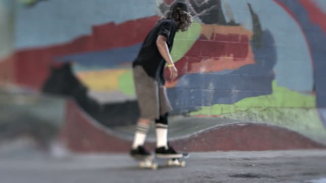 ms slo mo ts r/f shot of skater grinding / venice, california, united states - skateboard park stock videos & royalty-free footage