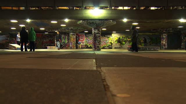 MS T/L LA Shot of Skaters at Southbank skate park at night / London, United Kingdom