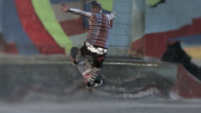 ms slo mo ts shot of skaters skating on ground / venice, california, united states - skateboard park stock videos & royalty-free footage