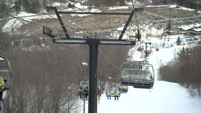 ms pov shot of ski lift whilst heading down incline / quebec, canada - ski lift stock videos & royalty-free footage