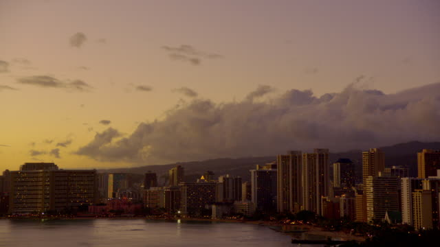 ws shot of  skyline over  water at dusk / honolulu hi, united states  - establishing shot点の映像素材/bロール