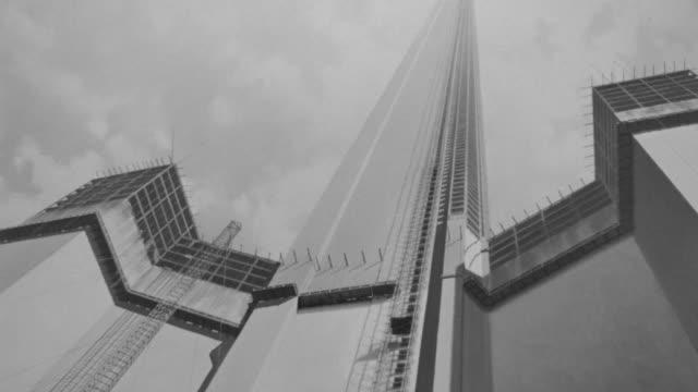 vídeos de stock, filmes e b-roll de ws la shot of skyscrapper that is under construction (miniature) - alto descrição geral