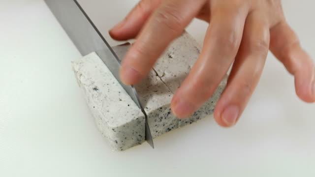 Shot of slicing Black Sesame Tofu