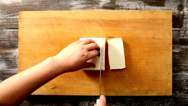 shot of slicing tofu with bare hands - soya bean stock videos & royalty-free footage