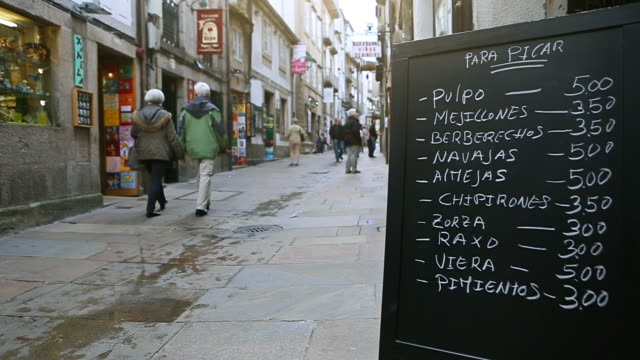 ms shot of small alleys of santiago de compostela and menu of typical restaurant of center of town - メニュー点の映像素材/bロール