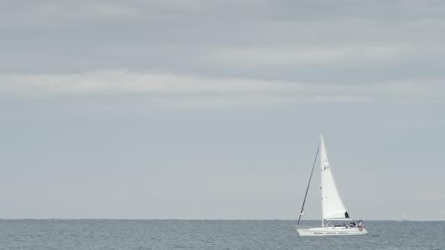 WS Shot of Small boat sailing / Barcelona, Catalunya, Spain