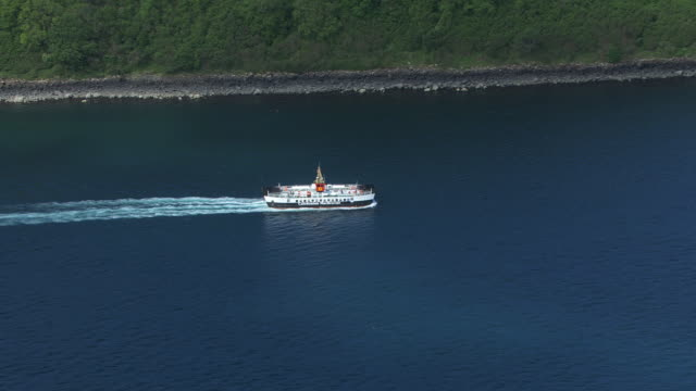 MS AERIAL ZO Shot of small Caledonian MacBrayne ferry on west coast / Isle or island of Mull, Argyll and Bute, Scotland
