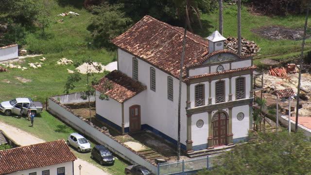 ms aerial shot of small church / minas gerais, brazil - minas stock videos and b-roll footage