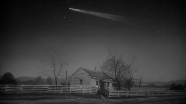MS ZO Shot of small country house with comet in sky