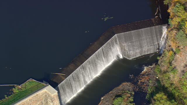 MS AERIAL ZI PAN ZO Shot of small dam / Connecticut, United States