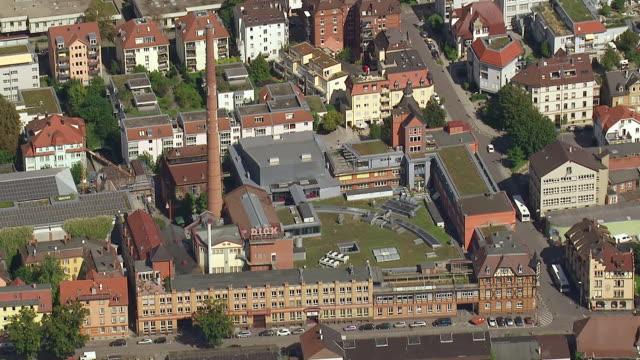 ms aerial ts shot of small industry surrounding by houses in stuttgart region / esslingen, baden wurttemberg, germany - menschliche siedlung stock-videos und b-roll-filmmaterial