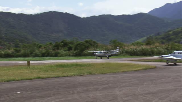 MS AERIAL TS Shot of small plane moving at runway / Rio de Janeiro, Brazil