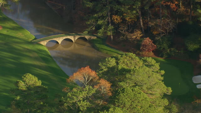 MS AERIAL Shot of small river in Augusta national golf course / Georgia, United States