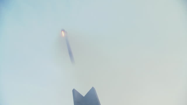 vidéos et rushes de ms la shot of small rocket is launched against early morning sky / baltimore, maryland, united states  - missile