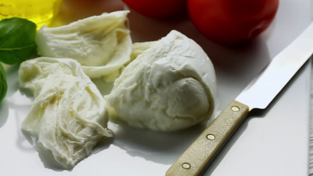 ms pan shot of small selection of traditional italian ingredients / london, united kingdom  - mozzarella stock videos & royalty-free footage