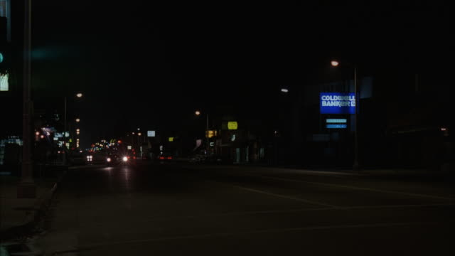 MS PAN Shot of small town main street with light traffic
