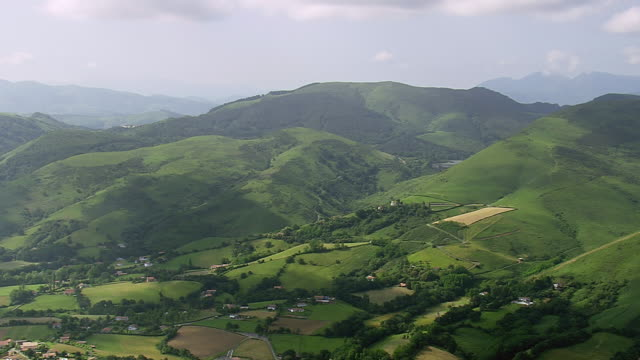 ws aerial shot of small village located at near mountain / basque country, france - aquitaine stock-videos und b-roll-filmmaterial