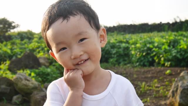 shot of smiling child's face - korea stock-videos und b-roll-filmmaterial