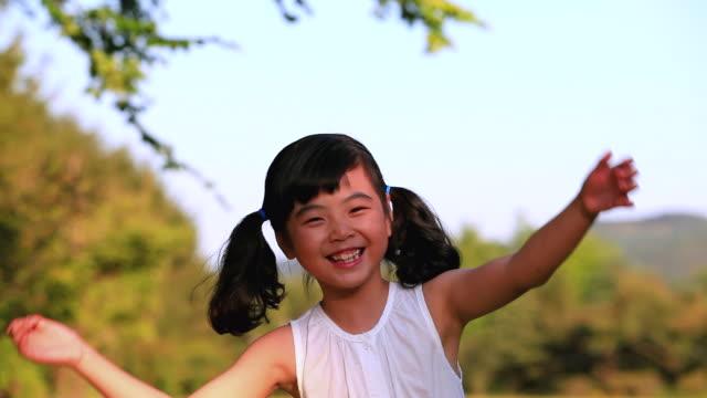 ms shot of smiling girl / paju, gyeonggido, south korea - pigtails stock videos & royalty-free footage