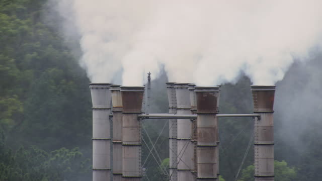 CU AERIAL ZO DS Shot of smoke coming out of chimneys from Industrial site / Minas Gerais, Brazil