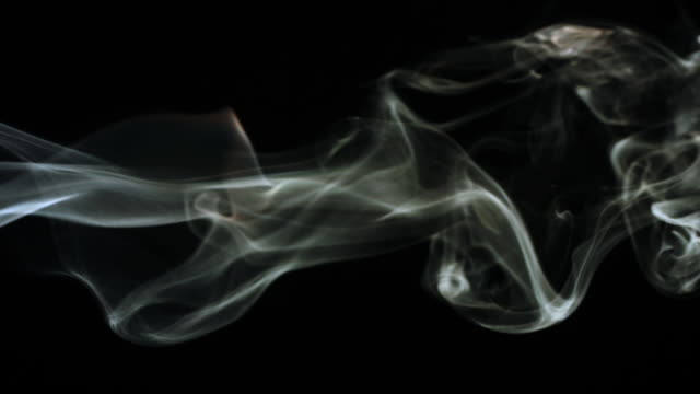 ms slo mo shot of smoke moving through frame from left to right - rauchen stock-videos und b-roll-filmmaterial