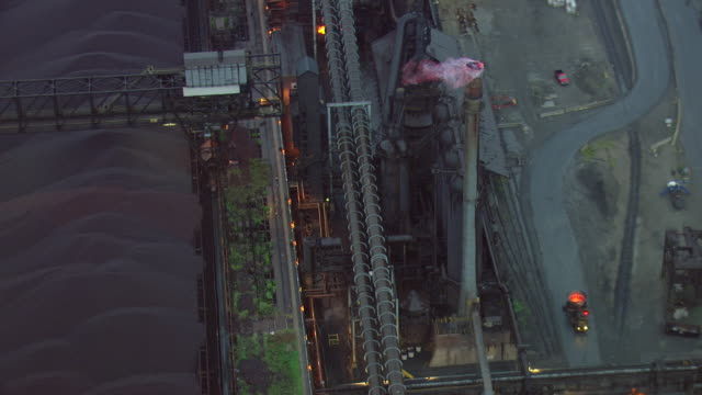 ms aerial ds shot of smoke stack with flame out from top of smoke stack / dearborn, michigan, united states - dearborn michigan stock videos and b-roll footage