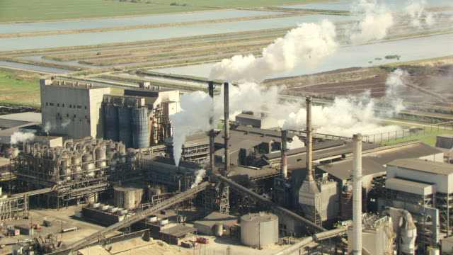 MS AERIAL Shot of smoke stacks at US Sugar Corp Factory in Hendry County / Florida, United States
