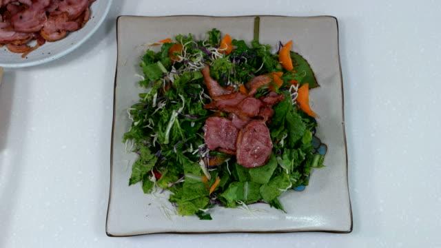Shot of Smoked Duck on Salad