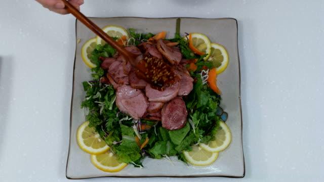 shot of smoked duck on salad - garnish stock videos & royalty-free footage