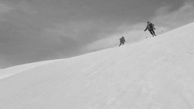 MS LA Shot of snow covering mountain, skier skies down mountain