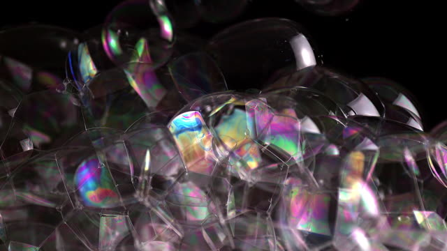 ecu slo mo shot of soap bubbles floating over black background / calvados, normandy, france  - soap sud stock videos & royalty-free footage