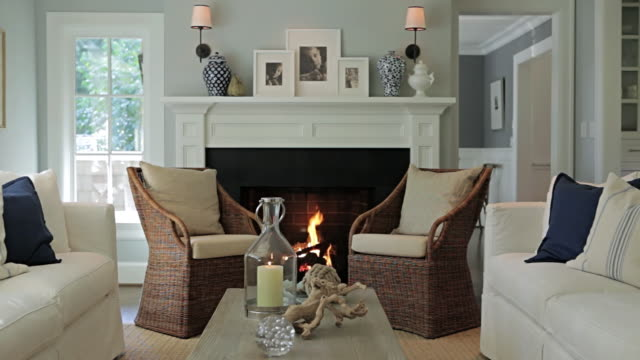 MS Shot of Sofas and fireplace in stylish home / Lake Oswego, Oregon, United States