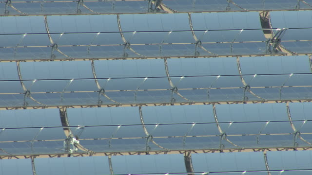 CU AERIAL Shot of solar panels at Nevada Solar One solar power plant in daylight / Boulder City, Nevada, United States