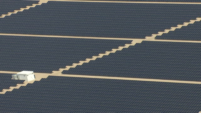MS AERIAL Shot of solar panels cluster in desert in daylight / Boulder City, Nevada, United States