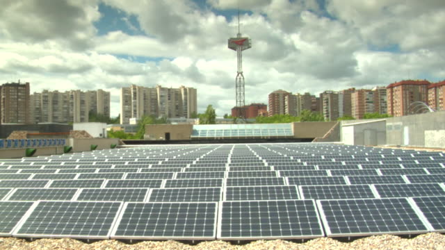 WS Shot of solar panels on roof of building with in city / Madrid, Spain