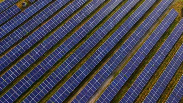 ms aerial shot of solar power plant / munich, bavaria, germany - solar panels stock videos & royalty-free footage