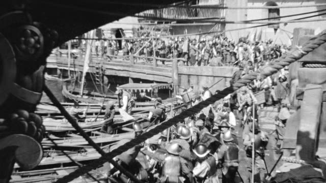 ms shot of solders marching at dock and climbing to board rowboats at dock - traditional helmet stock videos and b-roll footage