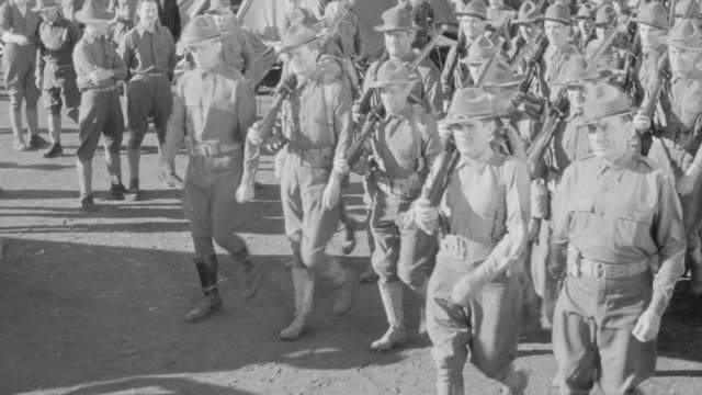 ms shot of soldier doing parade - campo militare video stock e b–roll