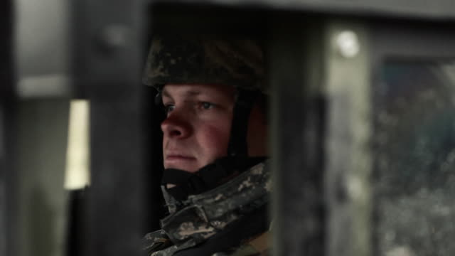 Shot of soldier sitting in a Humvee.