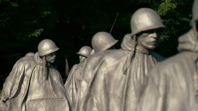 CU PAN Shot of soldier statues at Korean War Veterans Memorial / Washington, District of Columbia, United States