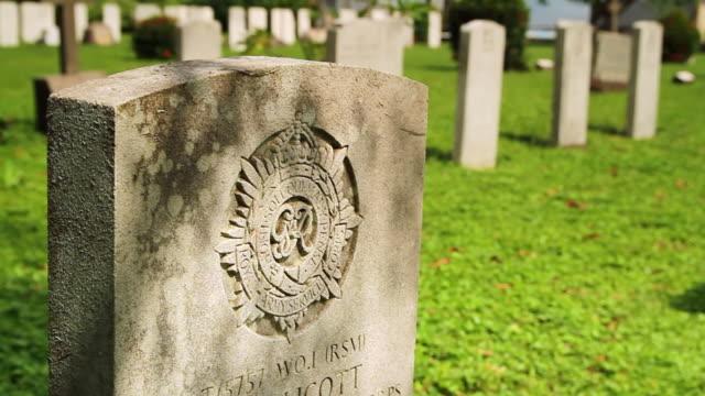 ECU Shot of Soldier's headstone in cemetery for fallen service men / Freetown, Sierra Leone