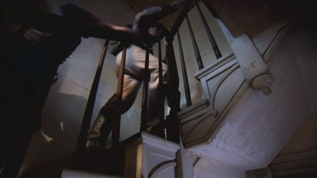 MS LA TU TS Shot of Soldiers holding rifles climb stairway inside house / Middleburg, Virginia, United States