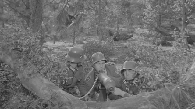 MS POV Shot of soldiers in machine gun nest during battle