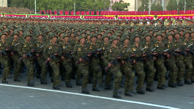 shot of soldiers marching in formation during a military parade at kim ilsung square pyongyang - military parade stock videos & royalty-free footage