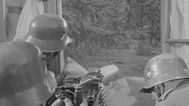 MS Shot of soldiers pointed machine gun nest during battle