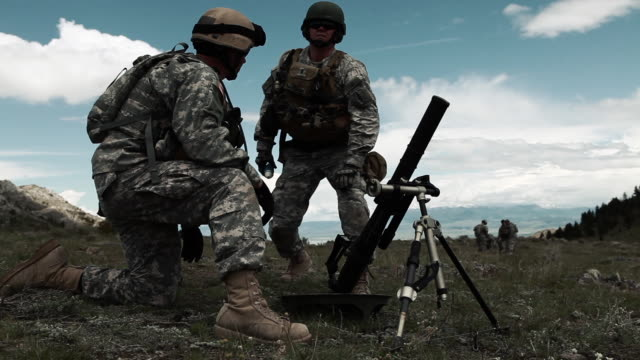 shot of soldiers preparing mortar launcher at training range. - shooting a weapon stock videos & royalty-free footage