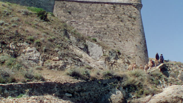 ws shot of some people walking trails castle - stone wall stock videos & royalty-free footage