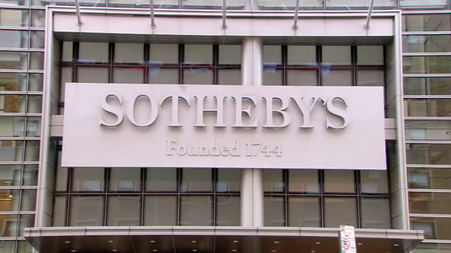 ms la shot of  sotheby's headquarters sign on exterior of building / new york, united states - sotheby's stock videos and b-roll footage