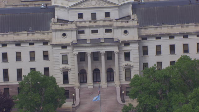 cu aerial ts zo shot of south dakota word on state capitol building and pull back to reveal entire building and surrounding area / pierre, south dakota, united states - south dakota stock videos and b-roll footage